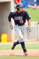 Joey Gallo #13 of AABC hustles down the first base line against Dixie at the 2011 Tournament of Stars at the USA Baseball National Training Center on June 25, 2011 in Cary, North Carolina.  The AABC defeated Dixie 4-2.  (Brian Westerholt/Four Seam Images)
