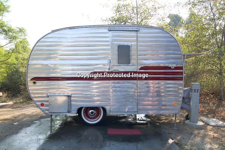 Silver and red striped 1954 Hanson Love Bug canned ham vintage travel trailer.