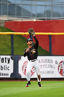 Quad Cities River Bandits outfielder Jason Martin (16) catches a fly ball during the first game of a doubleheader against the Wisconsin Timber Rattlers on August 19, 2015 at Modern Woodmen Park in Davenport, Iowa.  Quad Cities defeated Wisconsin 3-2.  (Mike Janes/Four Seam Images)