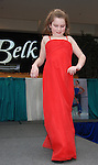Photo by Phil Grout..Emily Butz is about as pleased as she can be struting down the runway, modeling her red hot evening dress at the Dreams to Memories .fashion show during the Carroll County Chamber of Commerce fair..