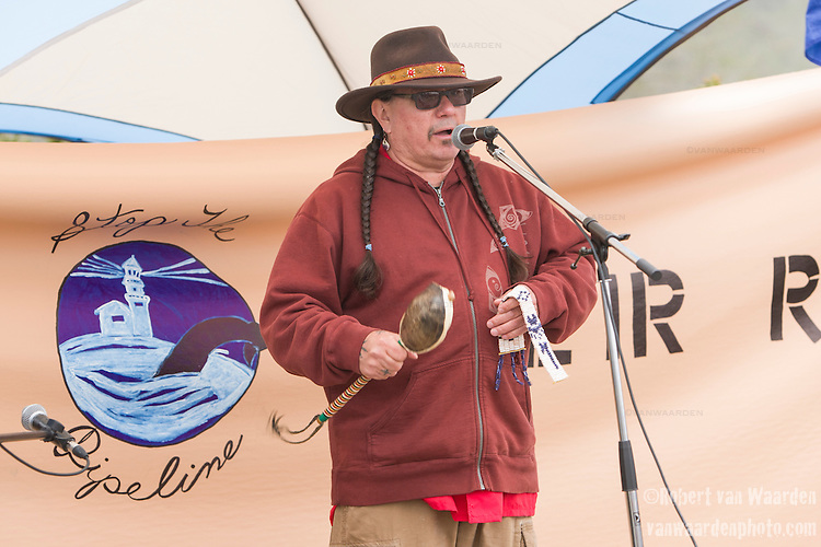 Ron Tremblay from the Wolastoq Grand Council speaks at the End of the Line. On May 30, 2015, over 500 Canadian citizens and First Nations marched in Red Head, Saint John, at the End of the Line for the proposed Energy East pipeline. The people were protesting the proposed mega pipeline and the tank terminal that would destroy and the Red Head community and endanger the Bay of Fundy. If approved, TransCanada's Energy East pipeline would travel 4600km from Alberta to Saint John, New Brunswick, shipping 1.1 million barrels of crude oil and bitumen for export through the Bay of Fundy, a critical habit for Right whales and home to thousands of jobs in Tourism and Fishing.