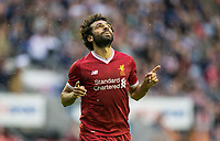 Mohamed Salah of Liverpool celebrates his first goal for the club on his debut during the pre season friendly match between Wigan Athletic and Liverpool at the DW Stadium, Wigan, England on 14 July 2017. Photo by Andy Rowland.