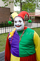 Happy court jester clown ready to march in the parade. MayDay Parade and Festival. Minneapolis Minnesota USA