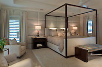 Clean modern guest bedroom with custom upholstered wall in neutrals