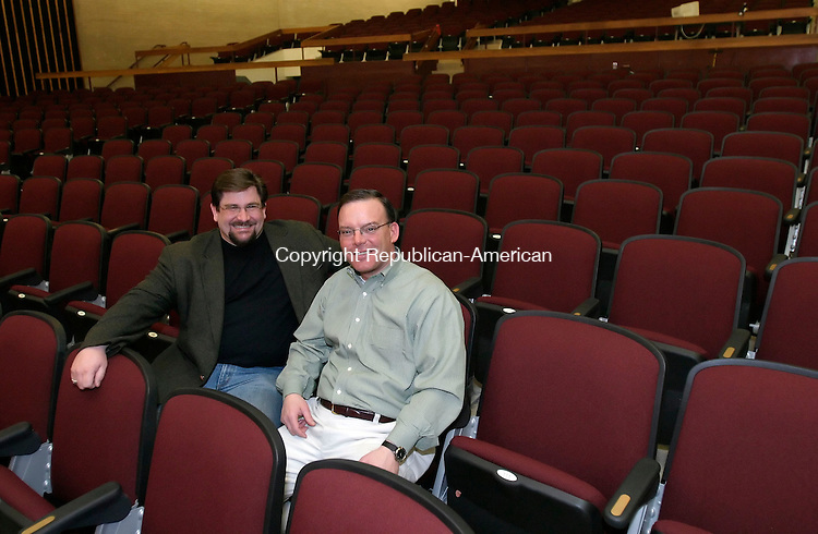 NAUGATUCK, CT, 01 April 2006- 040106BZ04- Charley Marenghi, a 5th grade teacher at Cross Street Intermediate School, and Rep. Kevin M. DelGobbo, R-Naugatuck, co-chairs of the Davis Auditorium Restoration Commmittee, pose in the recenty renovated chairs in the auditorium Saturday.<br />  Jamison C. Bazinet Republican-American