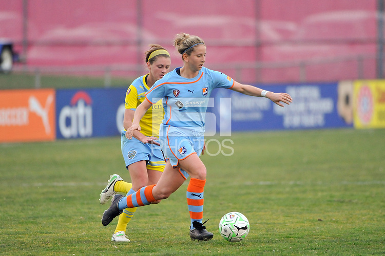 Carolyn Blank (31) of Sky Blue FC is trailed by Sinead Farrelly (14) of the Philadelphia Independence. The Philadelphia Independence and Sky Blue FC played to a 2-2 tie during a Women's Professional Soccer (WPS) match at Yurcak Field in Piscataway, NJ, on April 10, 2011.