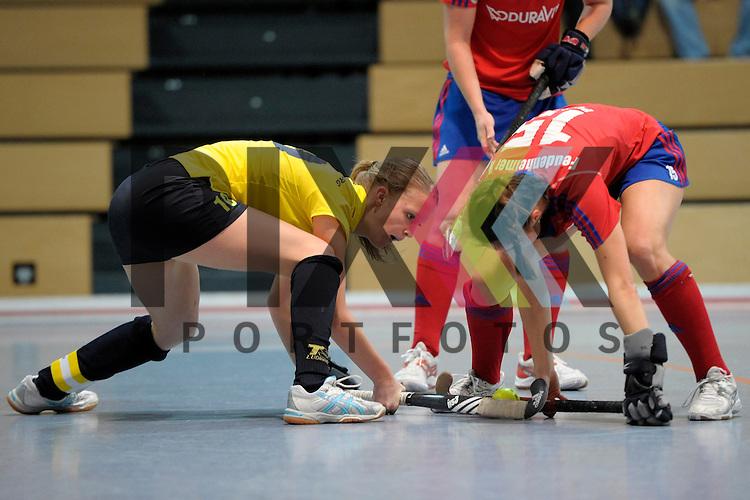 GER - Mannheim, Germany, January 17: During the Oberliga-Damen indoor hockey match between Feudenheimer HC (red) and  TSV Ludwigsburg (yellow) on January 17, 2016 at Irma-Roechling-Halle in Mannheim, Germany. Final score 8-2 (HT 3-1).  Sarah Kehm  #10 of TSV Ludwigsburg, Bettina Posset #15 of Feudenheimer HC<br /> <br /> Foto &copy; PIX-Sportfotos *** Foto ist honorarpflichtig! *** Auf Anfrage in hoeherer Qualitaet/Aufloesung. Belegexemplar erbeten. Veroeffentlichung ausschliesslich fuer journalistisch-publizistische Zwecke. For editorial use only.