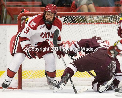 Danny Biega (Harvard - 9), Joe Wilson (Colgate - 25) - The Harvard University Crimson defeated the visiting Colgate University Raiders 4-2 on Saturday, November 12, 2011, at Bright Hockey Center in Cambridge, Massachusetts.
