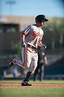 Glendale Desert Dogs center fielder Ryan McKenna (82), of the Baltimore Orioles organization, rounds third base after hitting a home run during an Arizona Fall League game against the Salt River Rafters at Salt River Fields at Talking Stick on October 31, 2018 in Scottsdale, Arizona. Glendale defeated Salt River 12-6 in extra innings. (Zachary Lucy/Four Seam Images)