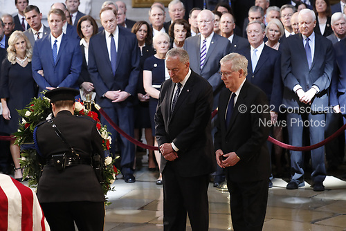 With mebers of Congress looking on, U.S. Senate Majority Leader Mitch McConnell (R-KY) and Minority Leader Chuck Schumer (D-NY) stand at the casket of late U.S. Senator John McCain as McCain lies in state inside the U.S. Capitol Rotunda in Washington, U.S., August 31, 2018. REUTERS/Kevin Lamarque
