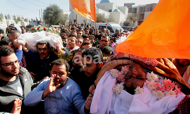 Mourners attend the funeral of Hatem al-Shalodi, a Palestinian who was killed after reportedly carrying out a stabbing attack on Israeli soldiers months ago, in the West Bank town of Hebron on January 7, 2017, after his body was returned by Israeli authorities. Photo by Wisam Hashlamoun
