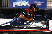 Jul. 26, 2013; Sonoma, CA, USA: A crew member pushes NHRA top fuel dragster driver Steve Torrence back toward the starting line during qualifying for the Sonoma Nationals at Sonoma Raceway. Mandatory Credit: Mark J. Rebilas-
