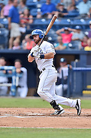 Asheville Tourists designated hitter Brian Mundell (15) swings at a pitch during a game against the Greenville Drive at McCormick Field on July 24, 2016 in Asheville, North Carolina. The Drive defeated the Tourists 12-5. (Tony Farlow/Four Seam Images)