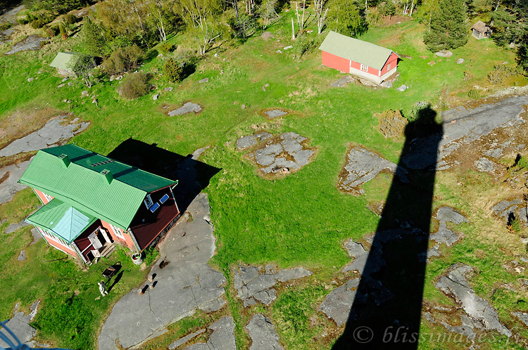 Säppi Lighthouse's shadow clears the keeper's cottage in early spring -Gulf of Bothnia, Finland