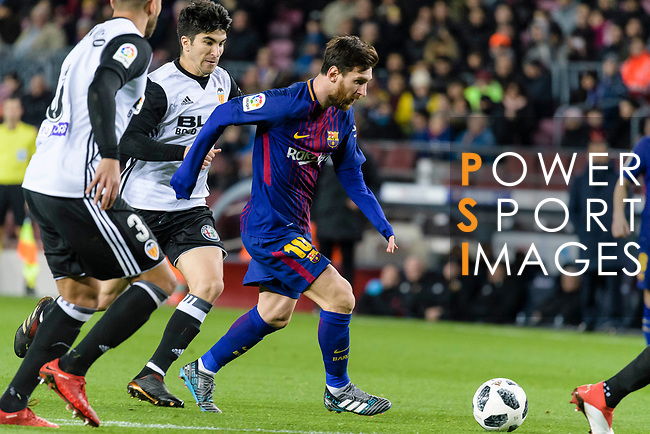 Lionel Messi of FC Barcelona (C) in action against Carlos Soler Barragan of Valencia CF (L) during the Copa Del Rey 2017-18 match between FC Barcelona and Valencia CF at Camp Nou Stadium on 01 February 2018 in Barcelona, Spain. Photo by Vicens Gimenez / Power Sport Images