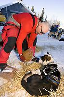 Paul Ellering Feeds Dogs @ McGrath Chkpt 2005 Iditarod