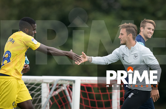 Nnamdi Ofoborh (on loan from Bournemouth) of Wycombe Wanderers & Brentford B coach Sam Saunders during the behind closed doors friendly between Brentford B and Wycombe Wanderers at Brentford Football Club Training Ground & Academy, 100 Jersey Road, TW5 0TP, United Kingdom on 3 September 2019. Photo by Andy Rowland.