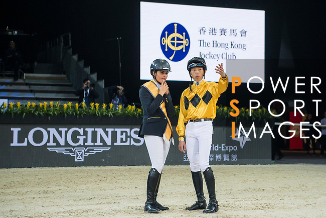 Riders and jockeys compete in the HKJC Race Of The Riders during the Longines Masters of Hong Kong at the Asia World Expo on 09 February 2018, in Hong Kong, Hong Kong. Photo by Diego Gonzalez / Power Sport Images