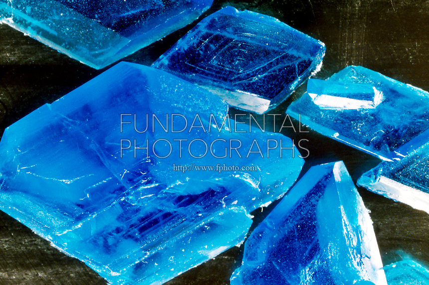 CUPRIC SULFATE PENTAHYDRATE CRYSTALS<br /> CuSO4*5H2O (Copper II Sulfate)<br /> Evaporation of a water solution of CuSO4 yields triclinic blue crystals of CuSO4. 5H2O, which is composed of hydrated copper ions, Cu(H2O)4 2+ and hydrated sulfate ions, SO4(H2O) 2-. Compound of small, highly positively charged ions commonly form hydrates.