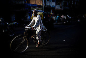 A muslim man cycles down the road in the old city of UP's capital city, Lucknow. Photo: Sanjit Das