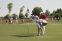 Martin Kaymer and Caddy remove the ball from the hole on the 3rd after a two.on day one of the Dubai World Championship on the Earth Course at the Jumeirah Golf Estate, Dubai..Picture Fran Caffrey/www.golffile.ie.