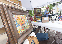 NWA Democrat-Gazette/FLIP PUTTHOFF <br /> HONORING DR. COMPTON<br /> Matt Coburn of Bentonville paints a nature scene on Satuday Aug. 10 2019 at Dr. Compton Day at Compton Gardens in downtown Bentonville. The annual event honors the late Dr. Neil Compton, a Bentonville physician. He was a founder of the Ozark Society which was instrumental in keeping the Buffalo National River free of dams. Dr. Compton championed  conservation efforts in Arkansas and beyond. The aluminum canoe he paddled is on display at Compton Gardens, two blocks north of the town square.