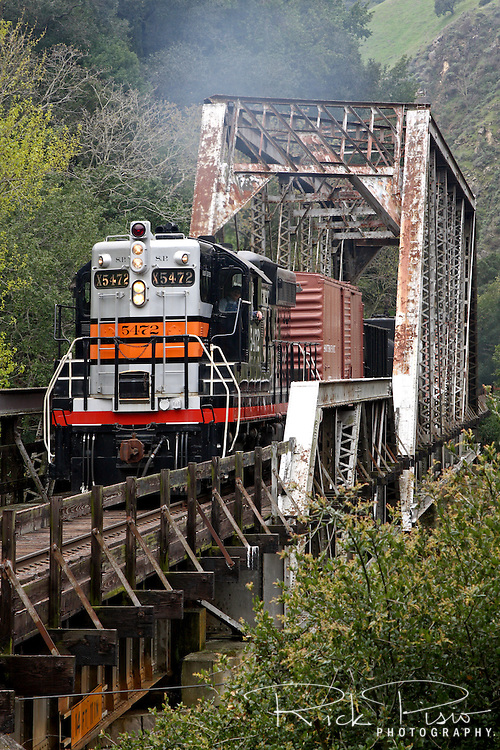 Southern Pacific SD-9 Diesel #5472 crossing a trestle in the Sunol Canyon. Southern Pacific diesel number 5472 was built by GM EMD in La Grange, Il and delivered to SP in 1956.