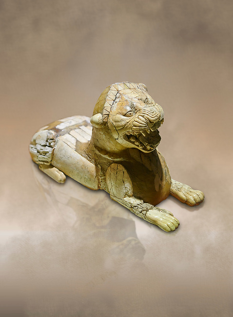 Phrygian ivory statuette carved as a roaring lion lying down from a table base decoration. From Gordion. Phrygian Collection, 8th-7th century BC - Museum of Anatolian Civilisations Ankara. Turkey. Against an art background
