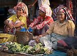 Old women set up shop at the Warloka market, Flores