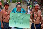"Holding a sign that proclaims ""No"" in Portuguese, a woman participates in a march by indigenous people through the streets of Atalaia do Norte in Brazil's Amazon region on March 27, 2019. They were protesting a central government plan to turn control of health care over to municipalities, in effect destroying a federal program of indigenous health care. Indian rights activists are worried that the government of President Jair Bolsonaro is reducing or eliminating protections for the country's indigenous people."