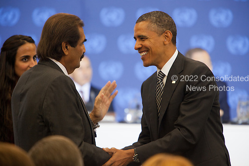 United States President Barack Obama, right, greets Amir Sheikh Hamad bin Khalifa Al-Thani, second left, prior to a meeting of the Libya Contact Group at the United Nations in New York, New York on Tuesday, September 20, 2011..Credit: Allan Tannenbaum / Pool via CNP
