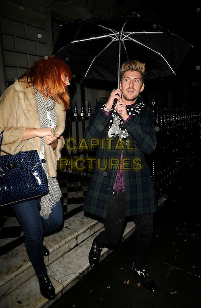GUEST & HENRY HOLLAND.Triflow Concepts re-launch party, the Red Mansion Foundation, Portland Place, W1, London, England..January 28th, 2009.full length black white polka dot scarf jeans denim blue green plaid tartan coat jacket umbrella patent leopard print bag purse beige fur .CAP/CAN.©Can Nguyen/Capital Pictures.