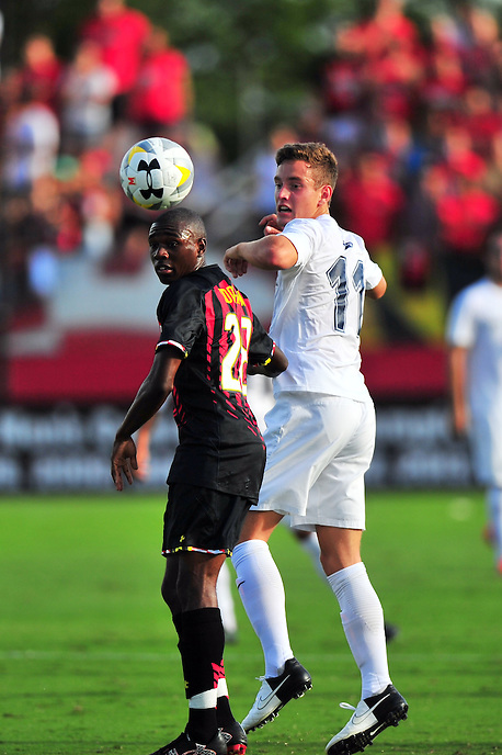 Terrapins Chris Odoi-Atsem headers the ball. Maryland defeated Penn State in over time 3-2 during an NCAA D-1 soccer match at Ludwig Field in College Park, MD on Sunday, September 18, 2016.  Alan P. Santos/DC Sports Box