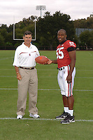 7 August 2006: Stanford Cardinal head coach Walt Harris and Michael Okwo during Stanford Football's Team Photo Day at Stanford Football's Practice Field in Stanford, CA.