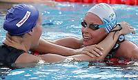 Italy's Federica Pellegrini, right, is congratulated by Britain's Joanne Jackson after setting the new world record clocking 3.59.15 during the women's 400 meters freestyle at the Swimming World Championships in Rome, 26 July 2009..UPDATE IMAGES PRESS/Riccardo De Luca
