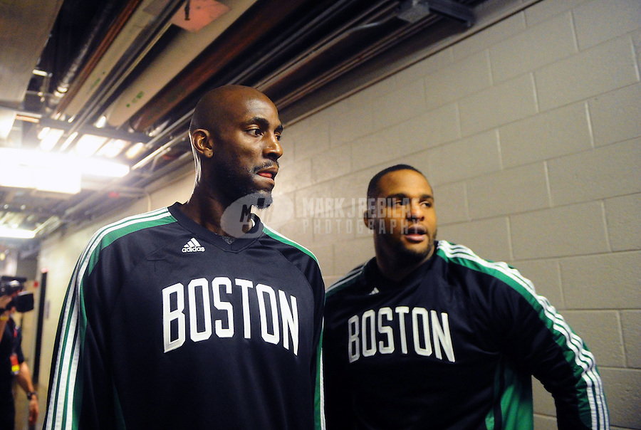 Jan. 28, 2011; Phoenix, AZ, USA; Boston Celtics forward Kevin Garnett (left) and forward Glenn Davis against the Phoenix Suns at the US Airways Center. Mandatory Credit: Mark J. Rebilas-