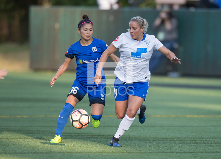 Seattle, WA - Saturday July 15, 2017: Nahomi Kawasumi, Adriana Leon during a regular season National Women's Soccer League (NWSL) match between the Seattle Reign FC and the Boston Breakers at Memorial Stadium.