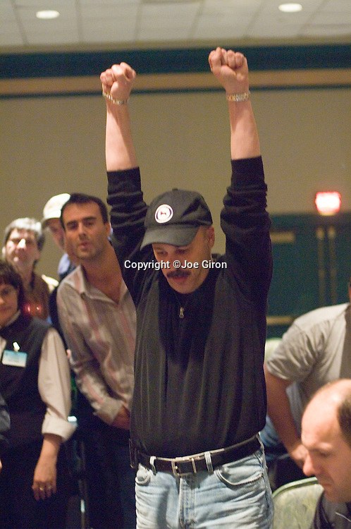 Bruce Kater Doubles Up..Spiro Mitrokostas raises to $27,000 and Bruce Kater moves all in for $49,000 more. Mitrokostas calls and shows Ks-10c. Kater flips over Ad-Jd and the board comes 6s-4h-3h-Ac-4d. Bruce Kater has doubled up to around $160,000.