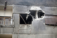 A hole in the wall of an apartment block hit by a shell in the eastern Damscus suburb of Sakba after an assault by government forces in their attempt to retake the area from the Free Syrian army. Protests against the ruling Baathist regime of Bashar al-Assad erupted in March 2011. Although they were initially peaceful,  they were violently repressed by the Syrian army and police. In response to being ordered to shoot unarmed civilians, large numbers of men deserted the army and formed the Free Syrian Army. The protest movement has now turned into an armed uprising with clashes between the regular army and the Free Syrian Army taking place in early 2012..