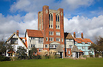 Eccentric mock Tudor architecture of water tower and houses, Thorpeness, Suffolk, England