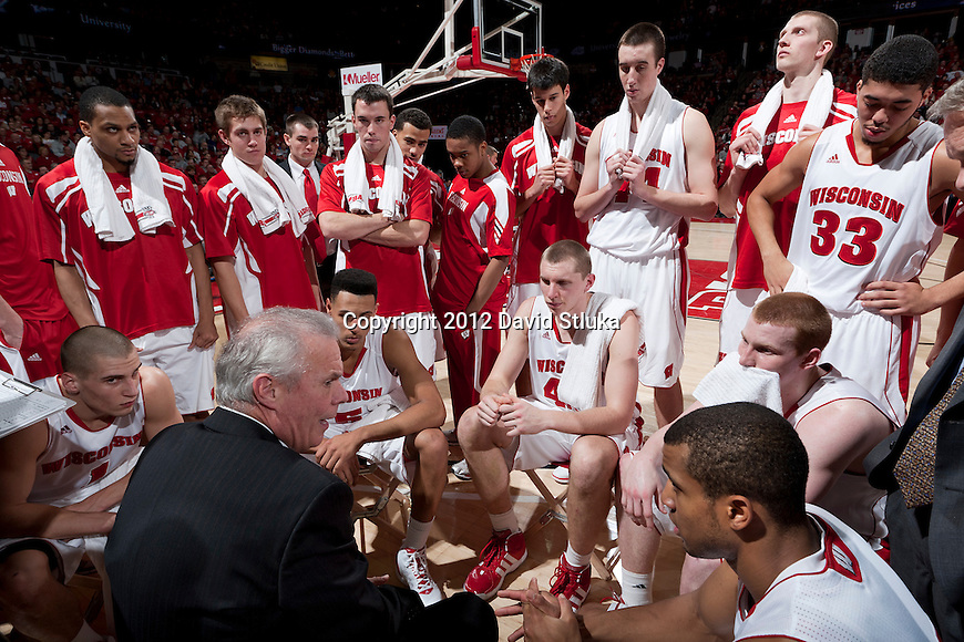 Wisconsin Badgers Head Coach Bo Ryan talks to his team during a Big Ten Conference NCAA college basketball game against the Northwestern Wildcats on January 18, 2012 in Madison, Wisconsin. The Badgers won 77-57. (Photo by David Stluka)