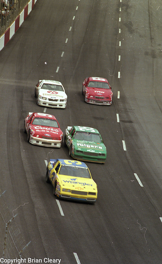 Dale Earnhardt (3) leads a pack of cars during the Southern 500, Darlington Raceway, Darlington, SC, September 1987. (Photo by Brian Cleary/www.bcpix.com)