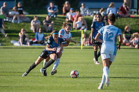 Kansas City, MO - Sunday May 07, 2017: Shea Groom, Maddy Evans during a regular season National Women's Soccer League (NWSL) match between FC Kansas City and the Orlando Pride at Children's Mercy Victory Field.