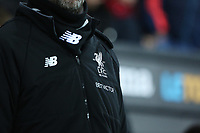 The BetVictor logo sits under the 125 Years Liverpool Crest on Jurgen Klopps New Balance coat prior to kick off of  the Premier League match between Swansea City and Liverpool at the Liberty Stadium, Swansea, Wales, UK. Monday 22 January 2018