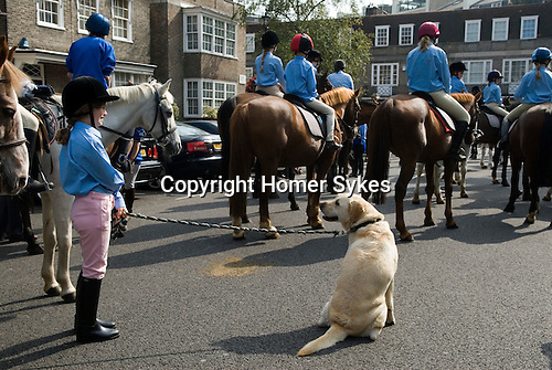 "Horsemans Sunday. Horsemans Sunday, London.  The vicar of St John's Church Hyde Park, appears before his congregation on a horse in the well established St John's tradition known as Horseman's Sunday. The Reverend Stephen Mason traditionally leads a cavalcade of over 100 horses and riders to the church in order to celebrate horse riding in the heart of London. The horses gather on the forecourt of the church for a blessing, followed by a ride-past and a presentation of rosettes. The annual Horseman's Sunday celebrations began nearly 40 years ago in 1968 to highlight the need to maintain stables along the north of Hyde Park; at that time the stables were threatened with closure. What began as a public and political action has become a unique local institution attracting local residents, tourists and horse lovers. As the Revd Mason says, ""This occasion is one of the most colourful events in the Hyde Park calendar. After all, how often do you get to see a cloaked member of the clergy on horseback these days? The Reverend Stephen Mason of St Johns Hyde Park and The Reverend Christopher Burke the Rector of Stepeny at the end of the service with girls from a local stable"