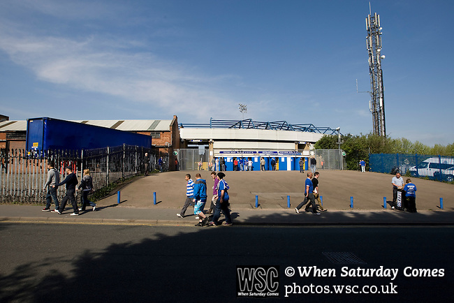 Birmingham City 1 Wolverhampton Wanderers 1, 01/05/2011. St Andrews, Premier League. Fans walking past the entrance to the Tilton Road stand at St. Andrew's stadium, prior to Birmingham City's Barclay's Premier League match with Wolverhampton Wanderers. Both clubs were battling against relegation from  England's top division. The match ended in a 1-1 draw, watched by a crowd of 26,027. Photo by Colin McPherson.