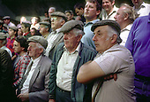 Farmers watch the bidding at a cattle sale in Dollgellau livestock market, North Wales.