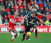 5th November 2017, Riverside Stadium, Middlesbrough, England; EFL Championship football, Middlesbrough versus Sunderland; Martin Braithwaite of Middlesbrough hits a pass to the wing with Lee Cattermole of Sunderland unable to stop him in the second half of the 1-0 win