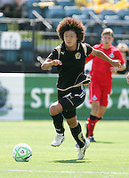 Eriko Arakawa dribbles the ball. FC Gold Pride defeated Washington Freedom 3-2 at Buck Shaw Stadium in Santa Clara, California on August 1, 2009.