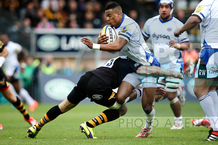 Bath's Jonathan Joseph tackled by London Wasps' Elliot Daly - Rugby Union - 2014 / 2015 Aviva Premiership - Wasps vs. Bath - Adams Park Stadium - London - 11/10/2014 - Pic Charlie Forgham-Bailey/Sportimage
